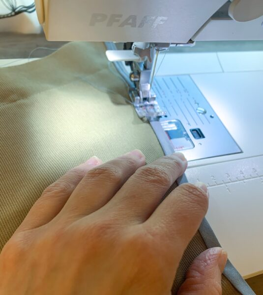 sewing bias tape on edge of sleeve