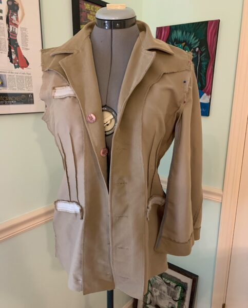 sleeve pinned to body of jacket
