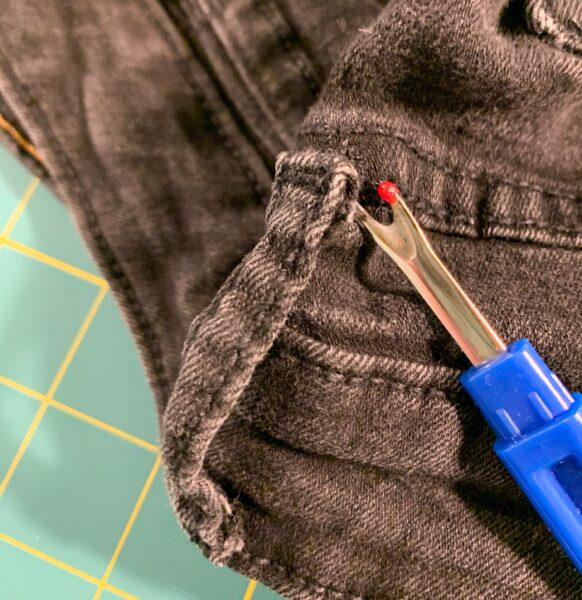 unpicking belt loop from jeans