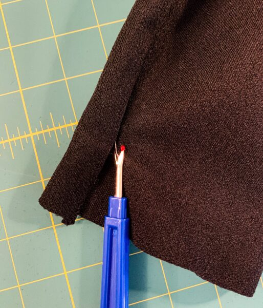 seam ripping slit in sleeve
