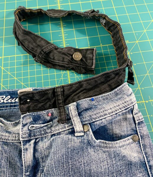 pinning waist of jeans into other jeans