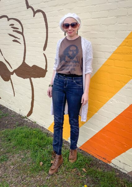 refashionista How to Make High Waisted Jeans from Low Waisted Jeans after in front of mural