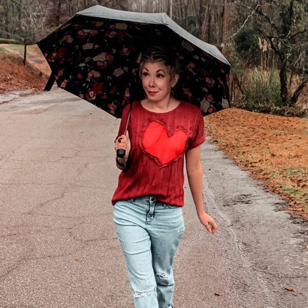 refashionista Valentine's Day Reverse Appliqué Heart Sweater in rain with umbrella
