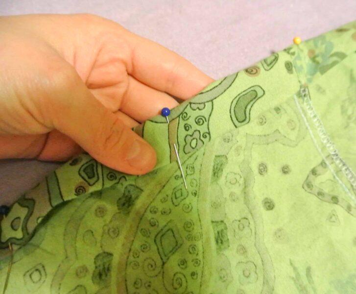 pinned hem of dress