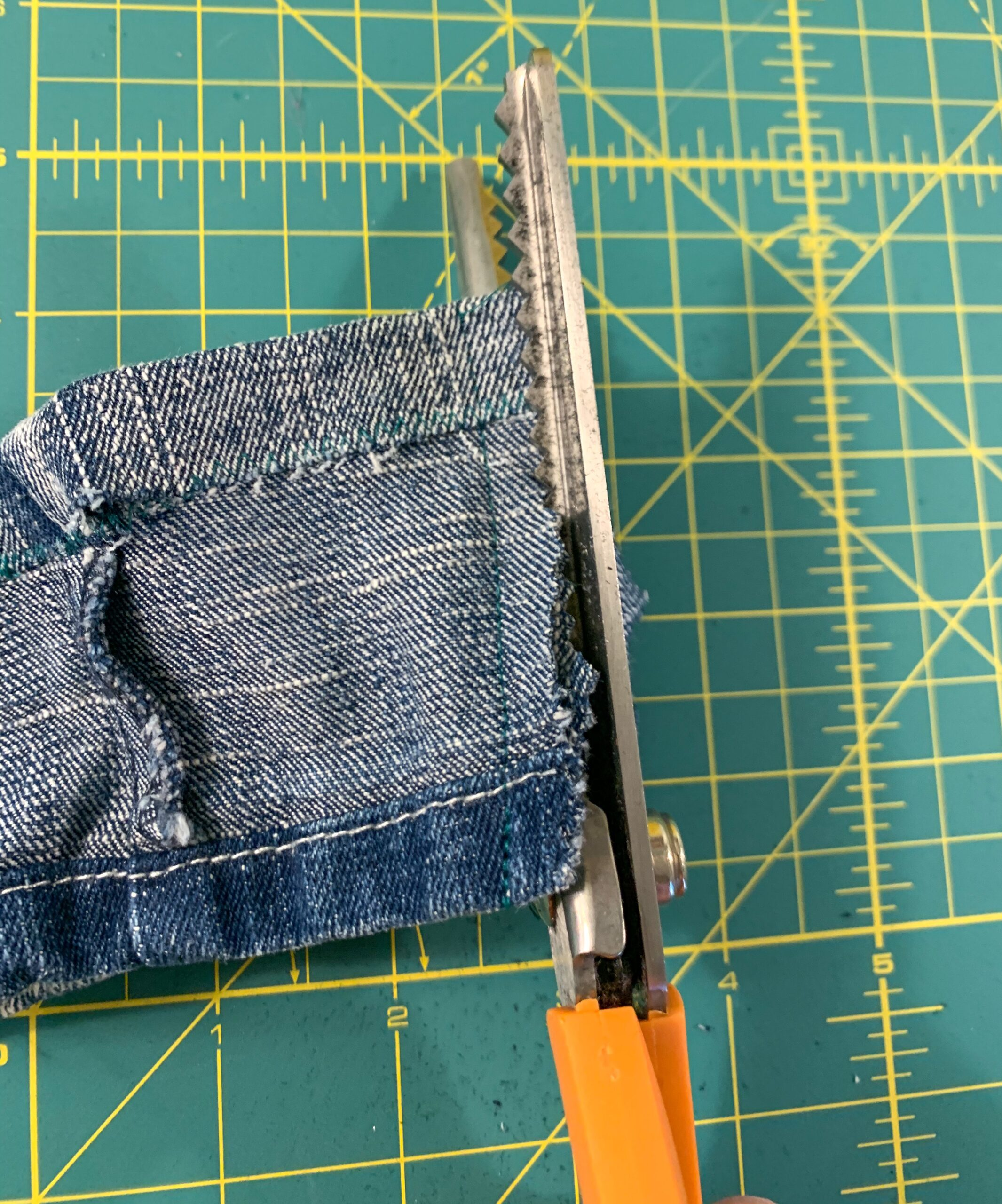 cutting off excess fabric with pinking shears
