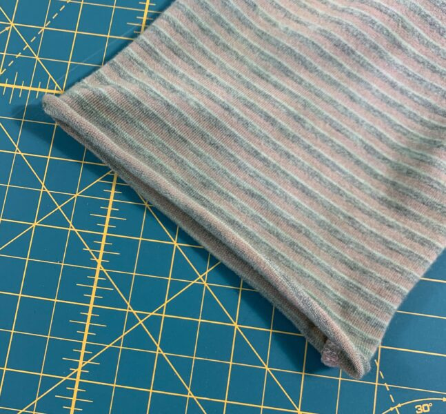 curled raw edge of sleeve