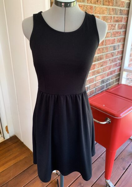 plain black dress on dress form
