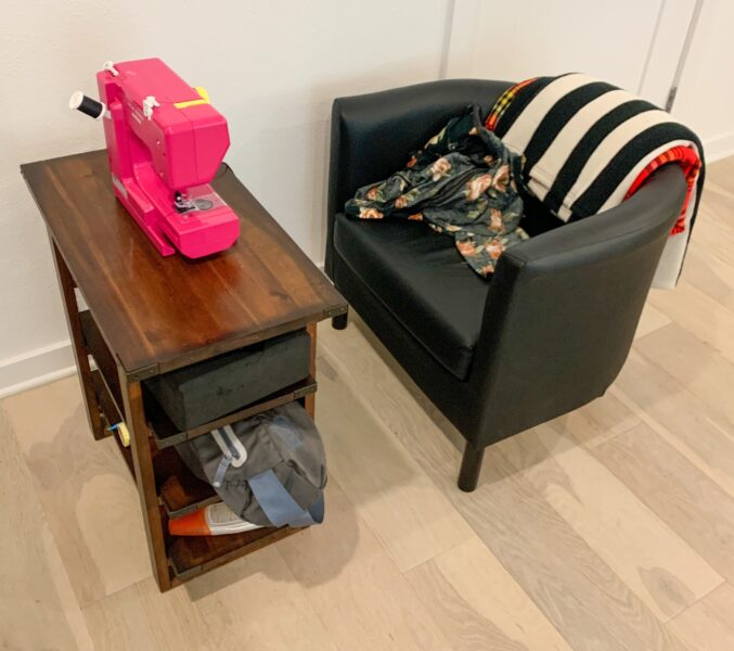 sewing machine on table with chair