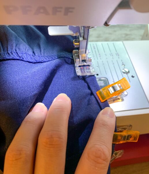 sewing arm hole of dress