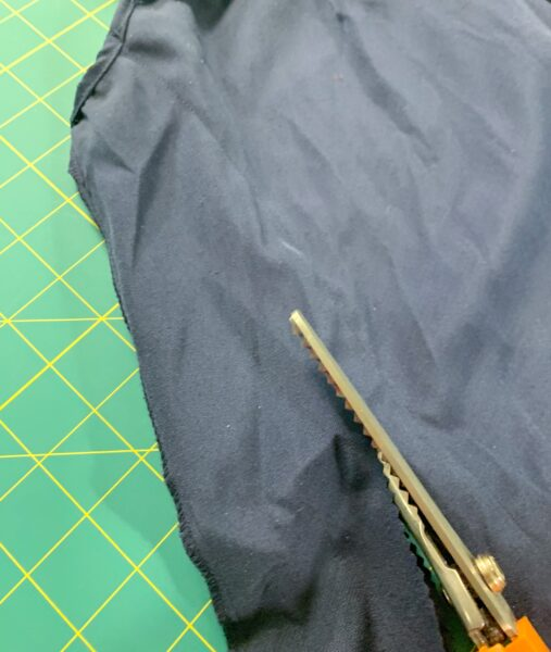 cutting off excess fabric