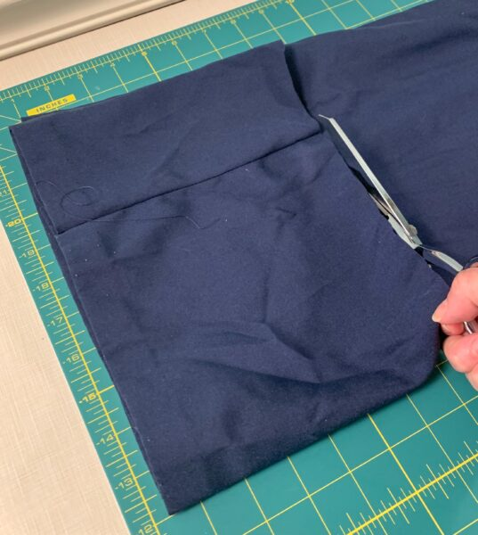 folding fabric over and cutting