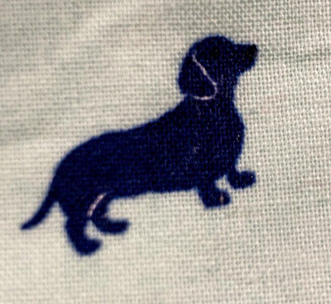 closeup of dachshund print on mask