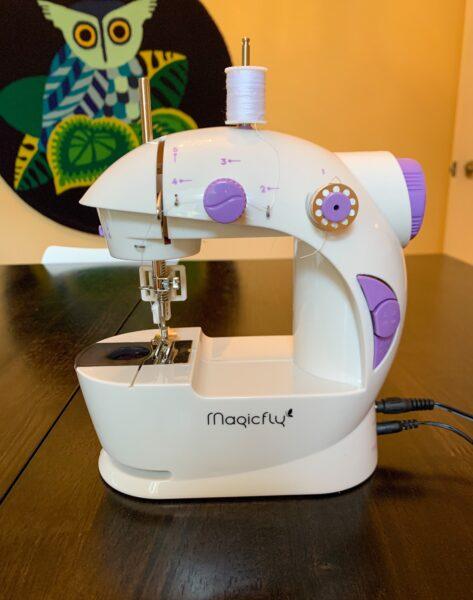 mini sewing machine on table