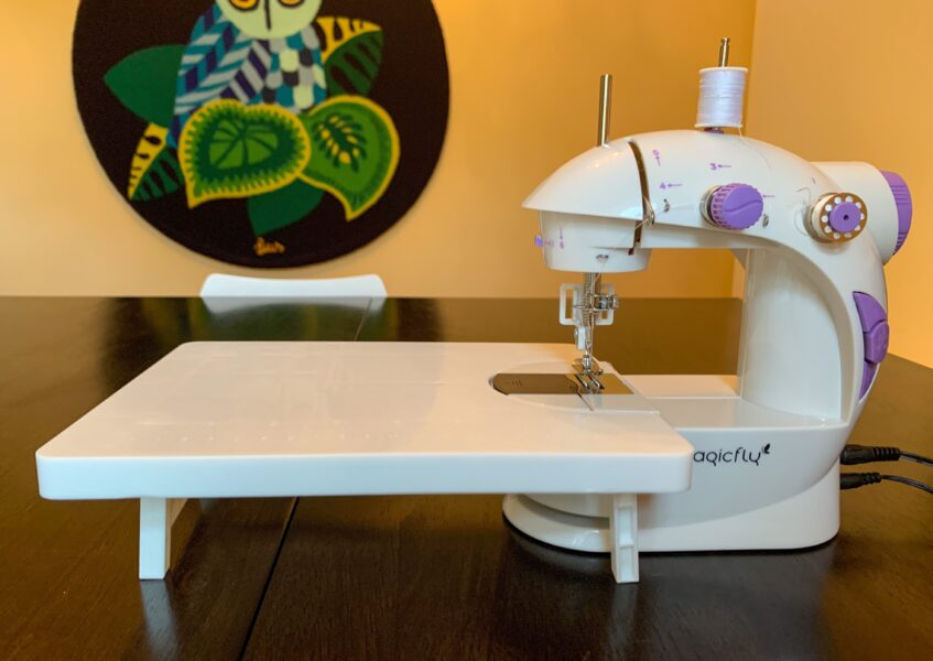 mini sewing machine on table with extension table