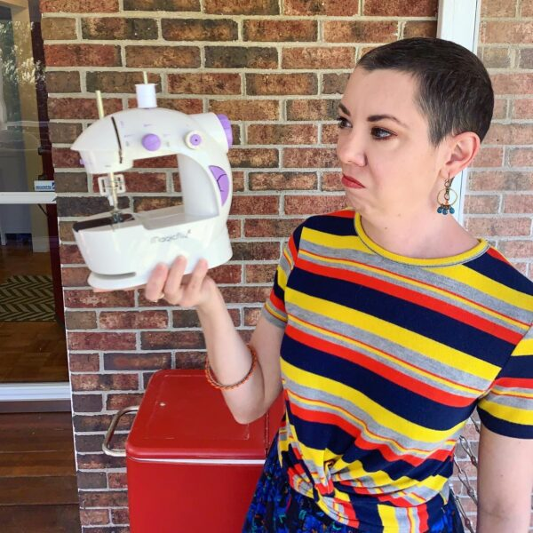 refashionista frowning at mini sewing machine