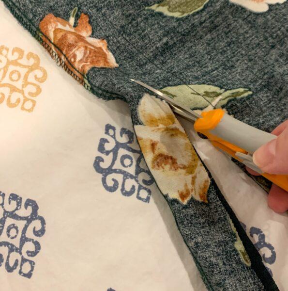 cutting off extra fabric