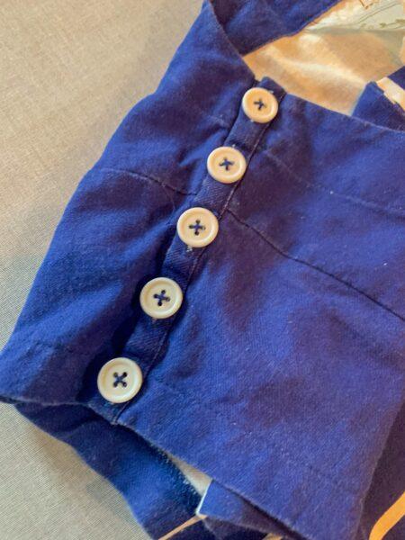buttons on shoulder of dress