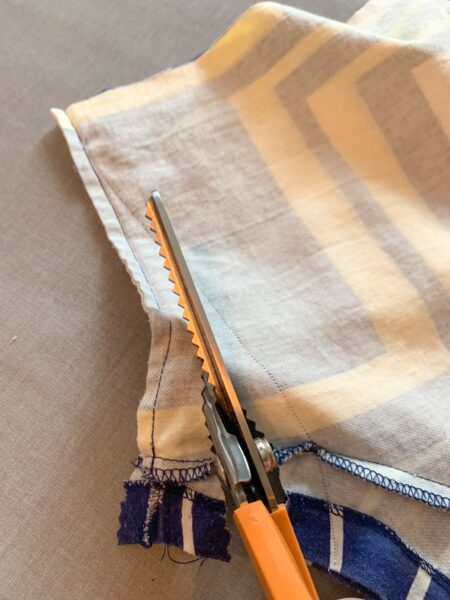 cutting off side of top with pinking shears