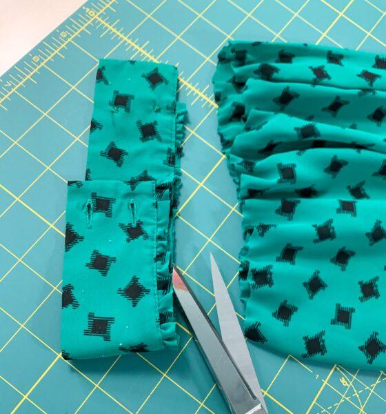 cutting off cuff of sleeve