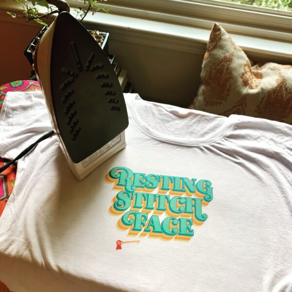 resting stitch face iron on T-shirt