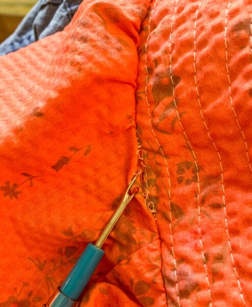 removing sleeves with seam ripper
