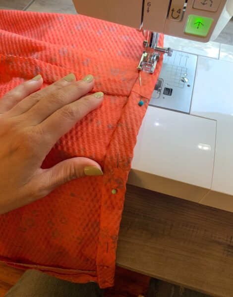 sewing hem of dress