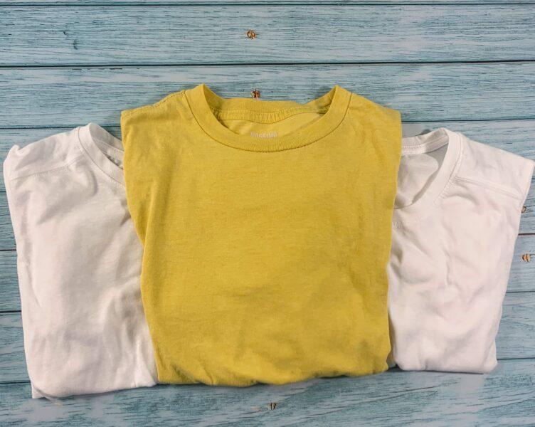 three t-shirts on table